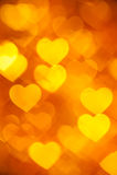 Χρυσή ανασκόπηση καρδιών Στοκ Εικόνες