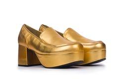 χρυσή γυναίκα παπουτσιών Στοκ Εικόνες