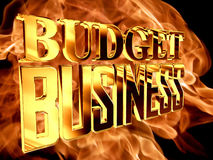 Χρυσή επιχείρηση προϋπολογισμών κειμένων στο υπόβαθρο πυρκαγιάς Στοκ Φωτογραφία