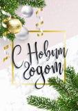 Χρυσή ευχετήρια κάρτα Χριστουγέννων με το ρωσικό κείμενο στοκ φωτογραφία με δικαίωμα ελεύθερης χρήσης