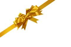 Χρυσή διαγώνιος γωνιών κορδελλών δώρων τόξων που απομονώνεται στοκ εικόνες