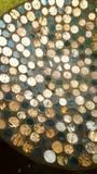 Χρυσή και πράσινη εργασία τέχνης νομισμάτων γυαλιού Στοκ Φωτογραφίες