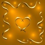 Χρυσή καρδιά μεταξιού με τις κορδέλλες πλαισίων Στοκ Εικόνες