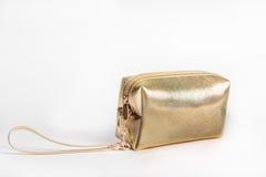 Χρυσή καλλυντική τσάντα Στοκ εικόνα με δικαίωμα ελεύθερης χρήσης
