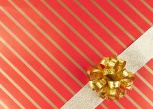 χρυσή κορδέλλα τόξων Στοκ Εικόνες