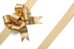 Χρυσή κορδέλλα με το τόξο Στοκ εικόνα με δικαίωμα ελεύθερης χρήσης