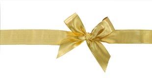 Χρυσή κορδέλλα το τόξο που απομονώνεται με στο λευκό Ψαλιδίζοντας το μονοπάτι συμπεριλαμβανόμενο Στοκ φωτογραφίες με δικαίωμα ελεύθερης χρήσης