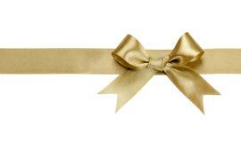 Χρυσή κορδέλλα το τόξο που απομονώνεται με στοκ εικόνες