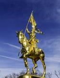 Χρυσή κυρία σε ένα χρυσό άλογο Στοκ Εικόνα