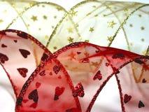 χρυσή κόκκινη κορδέλλα Χρ& Στοκ Εικόνες
