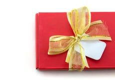 χρυσή κόκκινη κορδέλλα δώ&r Στοκ εικόνες με δικαίωμα ελεύθερης χρήσης