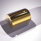 Χρυσή μπαταρία σε ένα γκρίζο υπόβαθρο Στοκ Εικόνες