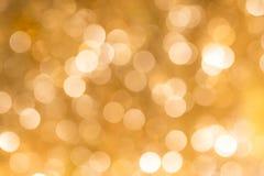 Χρυσή περίληψη θαμπάδων bokeh backgound Στοκ Φωτογραφία