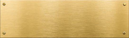 Χρυσή πινακίδα μετάλλων ή nameboard με τα καρφιά Στοκ φωτογραφία με δικαίωμα ελεύθερης χρήσης