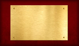 Χρυσή πινακίδα στην κόκκινη ανασκόπηση Στοκ Εικόνα