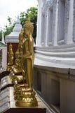 Χρυσή πλευρά αγαλμάτων του Βούδα του παρεκκλησιού Στοκ Εικόνες
