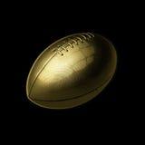Χρυσή σφαίρα ποδοσφαίρου στο μαύρο υπόβαθρο Στοκ Εικόνες