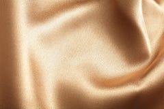 Χρυσή σύσταση μεταξιού Στοκ εικόνες με δικαίωμα ελεύθερης χρήσης