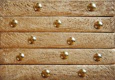 Χρυσή σύσταση με τα διακοσμητικά στοιχεία Στοκ Φωτογραφίες