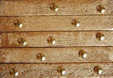 Χρυσή σύσταση με τα διακοσμητικά στοιχεία Στοκ Εικόνες