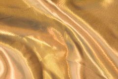 χρυσή σύσταση σατέν Στοκ φωτογραφία με δικαίωμα ελεύθερης χρήσης