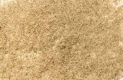 Χρυσή σύσταση σκόνης Φωτεινός λάμψτε Χρυσή επιφάνεια σκονών Κίτρινος ακτινοβολήστε Λάμποντας υπόβαθρο τσεκιών Στοκ Εικόνα