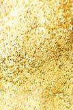 Χρυσή σύσταση σπινθηρίσματος Αφηρημένος χρυσός ακτινοβολεί υπόβαθρο Χρυσό μ Στοκ εικόνες με δικαίωμα ελεύθερης χρήσης