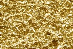 Χρυσή σύσταση υποβάθρου φύλλων αλουμινίου Μια πραγματική ανίχνευση του φύλλου αλουμινίου Στοκ Φωτογραφίες