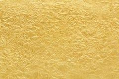 Χρυσή σύσταση υποβάθρου φύλλων αλουμινίου Στοκ Εικόνες