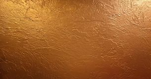 Χρυσή υπόβαθρο ή σύσταση και σκιά κλίσεων Λαμπρό κίτρινο υπόβαθρο σύστασης φύλλων αλουμινίου φύλλων χρυσό στοκ εικόνες