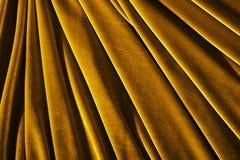 Χρυσή υφαντική φωτογραφία βελούδου χρώματος για το υπόβαθρο ή τη σύσταση Στοκ Φωτογραφίες