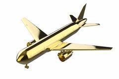 Χρυσή χλεύη επάνω στο αεροπλάνο Στοκ Φωτογραφίες