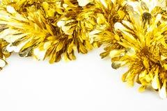 Χρυσή Tinsel διακόσμηση Χριστουγέννων Στοκ Φωτογραφίες