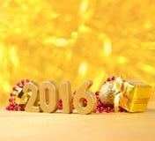 χρυσοί αριθμοί έτους του 2016 και διακοσμήσεις Χριστουγέννων Στοκ Εικόνα