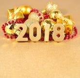χρυσοί αριθμοί έτους του 2018 και διακοσμήσεις Χριστουγέννων Στοκ Εικόνες