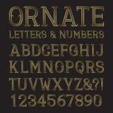 Χρυσοί περίκομψοι κεφαλαία γράμματα και αριθμοί με τα tendrils Decorat Στοκ Εικόνες