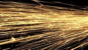 Χρυσοί σπινθήρες που πυροβολούν πέρα από το πλαίσιο φιλμ μικρού μήκους