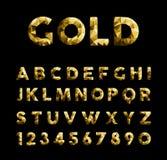 Χρυσοί χαμηλοί πολυ κομψοί αριθμοί χαρακτήρων πηγών abc Στοκ Φωτογραφίες