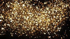 Χρυσός ακτινοβολήστε σκόνη στο μαύρο υπόβαθρο Εισαγωγή παφλασμών σπινθηρίσματος με τη χρυσή σκόνη Bokeh επίδραση υδρονέφωσης πυρά φιλμ μικρού μήκους