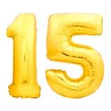 Χρυσός αριθμός 15 δεκαπέντε φιαγμένα από διογκώσιμο μπαλόνι Στοκ Εικόνες
