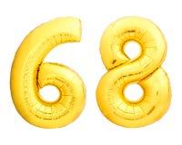 Χρυσός αριθμός 68 εξήντα οκτώ φιαγμένα από διογκώσιμο μπαλόνι Στοκ Εικόνες