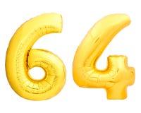 Χρυσός αριθμός 64 εξήντα τέσσερα φιαγμένα από διογκώσιμο μπαλόνι Στοκ Εικόνα