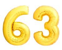 Χρυσός αριθμός 63 εξήντα τρία φιαγμένα από διογκώσιμο μπαλόνι Στοκ Εικόνες