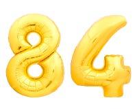 Χρυσός αριθμός 84 ογδόντα τέσσερα φιαγμένα από διογκώσιμο μπαλόνι Στοκ Εικόνες