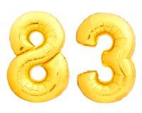 Χρυσός αριθμός 83 ογδόντα τρία φιαγμένα από διογκώσιμο μπαλόνι Στοκ Εικόνα