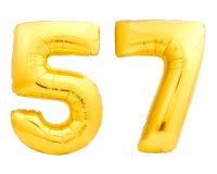 Χρυσός αριθμός 57 πενήντα επτά φιαγμένα από διογκώσιμο μπαλόνι Στοκ Φωτογραφίες