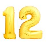 Χρυσός αριθμός 12 φιαγμένος από διογκώσιμο μπαλόνι Στοκ Φωτογραφία