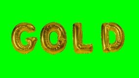 Χρυσός λέξης από τις επιστολές μπαλονιών ηλίου που επιπλέουν στην πράσινη οθόνη - απόθεμα βίντεο