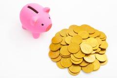 χρυσός νομισμάτων τραπεζών piggy Στοκ Φωτογραφία