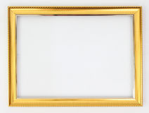 Χρυσός πλαισίων σε ένα άσπρο υπόβαθρο στοκ φωτογραφία με δικαίωμα ελεύθερης χρήσης